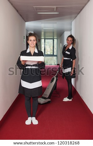 Two chambermaid women during service in a hotel.