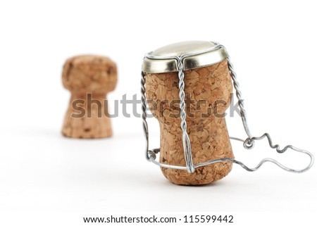 Two champagne corks close-up on white background