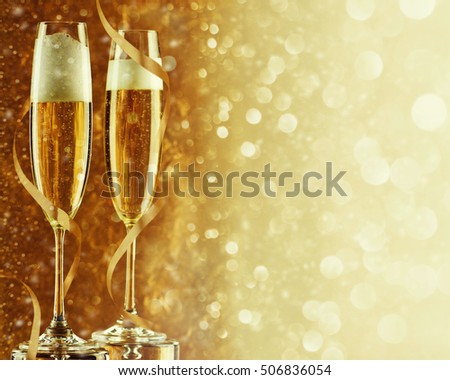 Two champagne flutes on gold shiny background #506836054