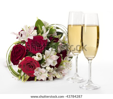 stock photo Two champagne flutes with wedding bouquet
