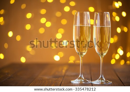 Two champagne glass on christmas bokeh background #335478212