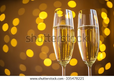 Two champagne glass on christmas bokeh background #335478221