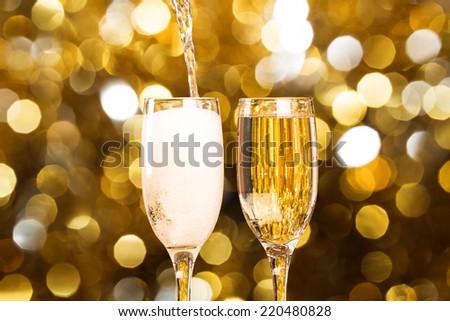 Two champagne glass on christmas bokeh background Two champagne glass on christmas bokeh background #220480828
