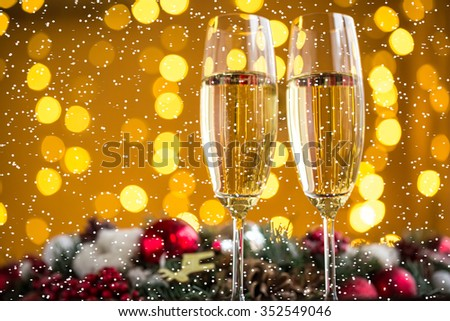 Two champagne glass on christmas bokeh background with snow #352549046