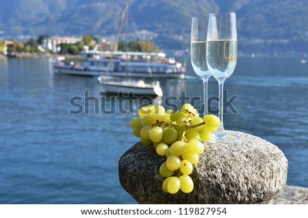 Two champagne glasses and grapes