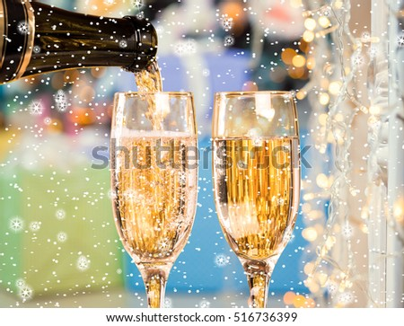 Two Champagne Glasses On Defocused Background Christmas Living Room With Christmas Tree with stars and snow. #516736399