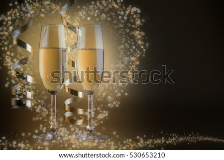 Two champagne glasses, on golden bokeh background #530653210