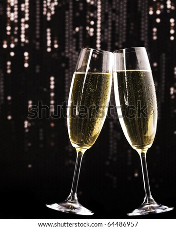 Two champagne glasses on holiday background