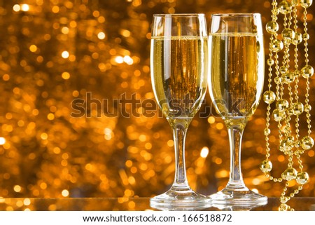 Two Champagne glasses on light bokeh background #166518872