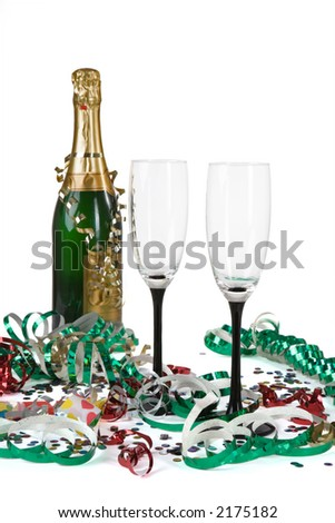 two champagne glasses on white and streamers, confetti and a noisemaker