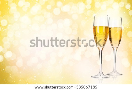 Two champagne glasses over christmas background with copy space #335067185