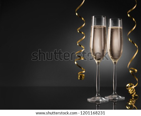 Two champagne glasses ready to bring in the New Year #1201168231