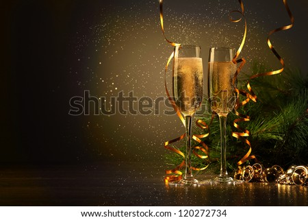 Two champagne glasses ready to bring in the New Year #120272734