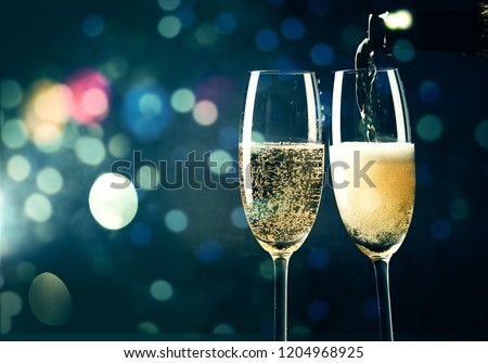 two champagne glasses ready to bring in the New Year #1204968925