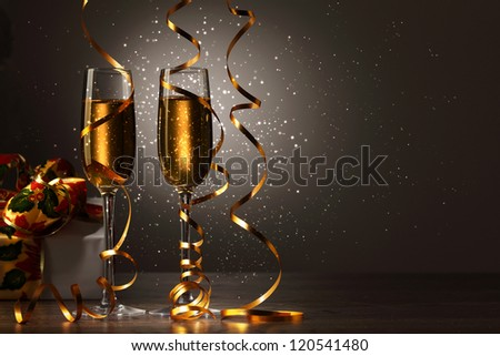 Two champagne glasses ready to bring in the New Year - Shutterstock ID 120541480