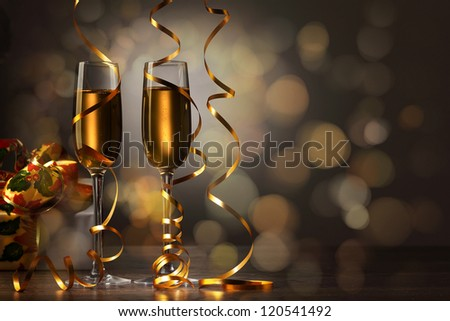 Two champagne glasses ready to bring in the New Year #120541492