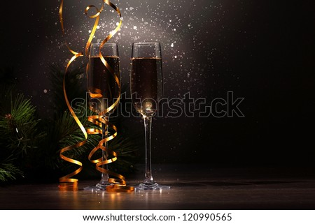 Two champagne glasses ready to bring in the New Year #120990565