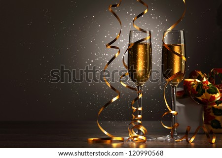 Two champagne glasses ready to bring in the New Year #120990568