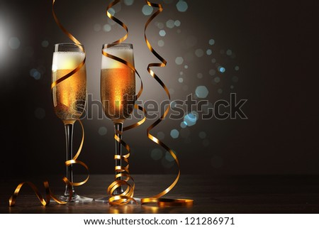 Two champagne glasses ready to bring in the New Year #121286971