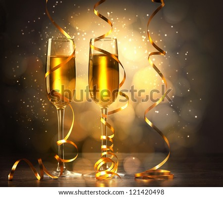 Two champagne glasses ready to bring in the New Year #121420498