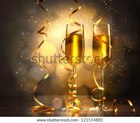 Two champagne glasses ready to bring in the New Year #121514881