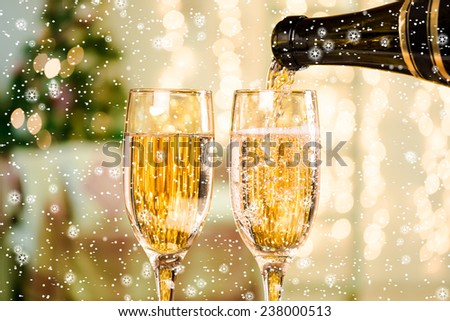 Two Champagne Glasses With Snow and Stars On Defocused Background Living Room With Christmas Tree #238000513