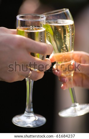 Two Champagne in hands of  new married couple closeup