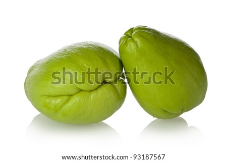 Two chayote squash, also known as christophine, pear-squash, vegetable pear and choko against a white background.