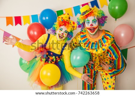 Photo of  Two cheerful clowns. Birthday for children. Bright clown and clowness.
