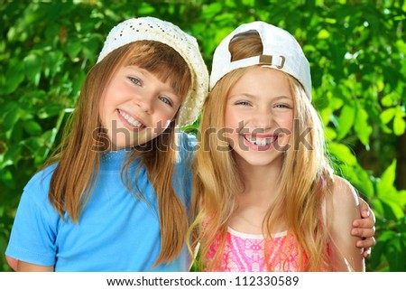 Two cheerful girls at the summer park
