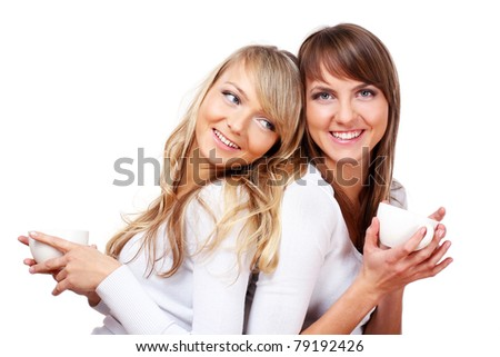 Two Cheerful Girls Drinking Coffee isolated over white background