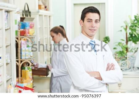 Two cheerful pharmacist chemist  worker standing in pharmacy drugstore