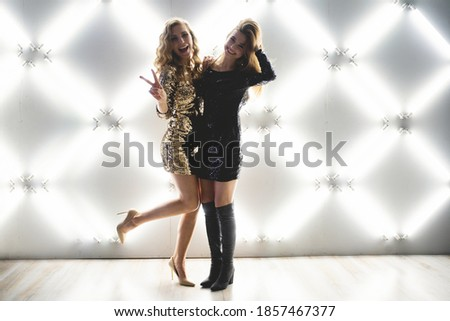 Two cheerful women posing in night dress isolated on a white background. Stock photo ©
