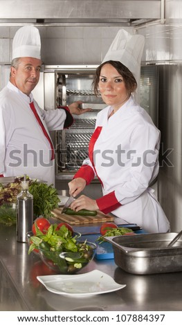 Two chefs at work in a restaurant