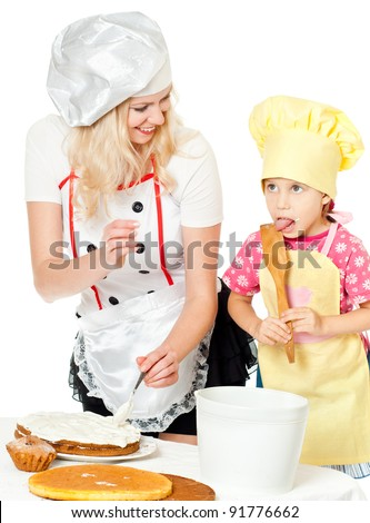 Two chefs rubs cream cake, white background