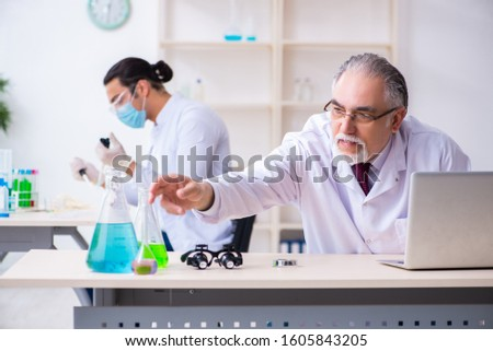 Two chemists working in the lab