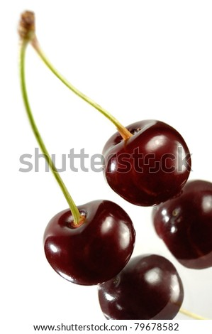 Two cherries close-up Isolated on white background