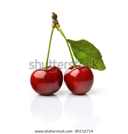 Two Cherries With Dewdrops On White Background