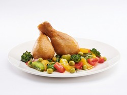 two chicken legs with vegetables