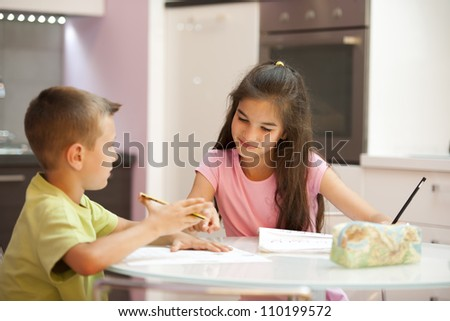 Two children doing their homework