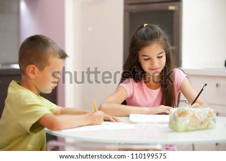 Two children doing their homework