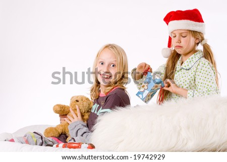Two children having a fight about the present