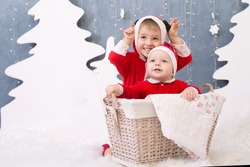 Two children in Christmas costumes