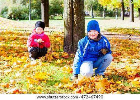 Two children in City Park in autumn