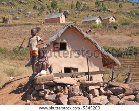 Two children in front of a house - Andringitra park - Madagascar.