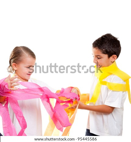 two children kids in a party with messy colorful paper ribbon - stock photo