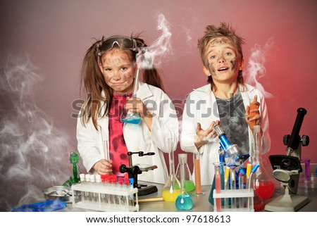Two children making science experiments. Education.