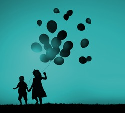 Two Children Outdoors Holding Balloons Concept
