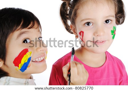 Two children painting on faces of each other