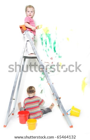 two children painting over white